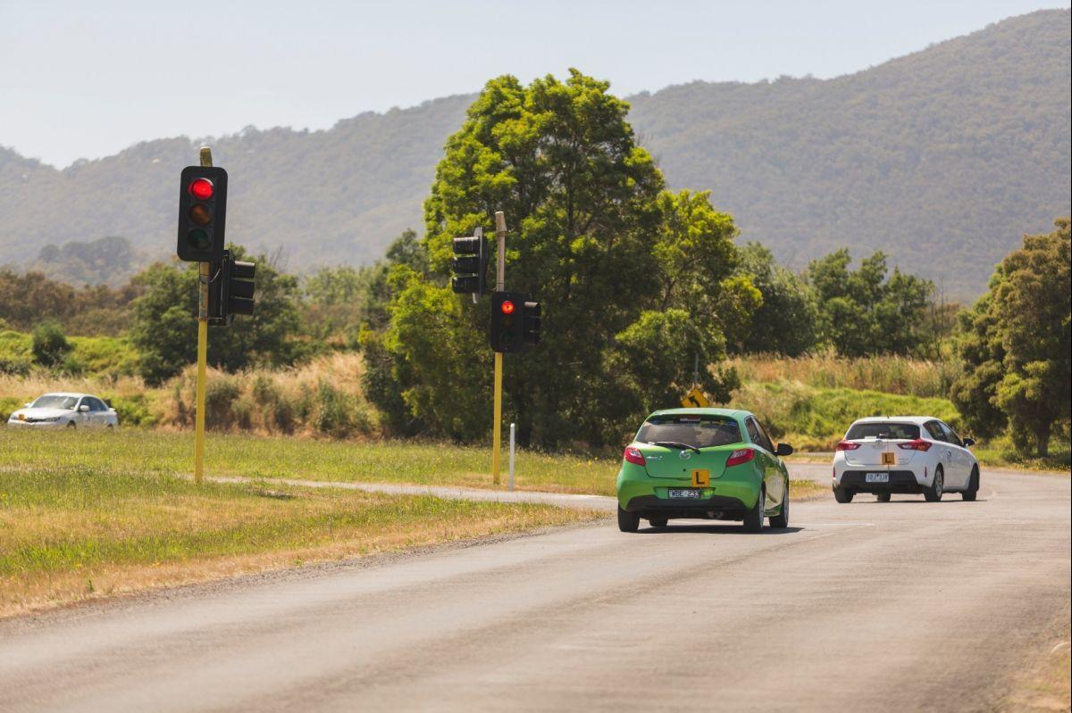 Green Mazda Learner At Lights