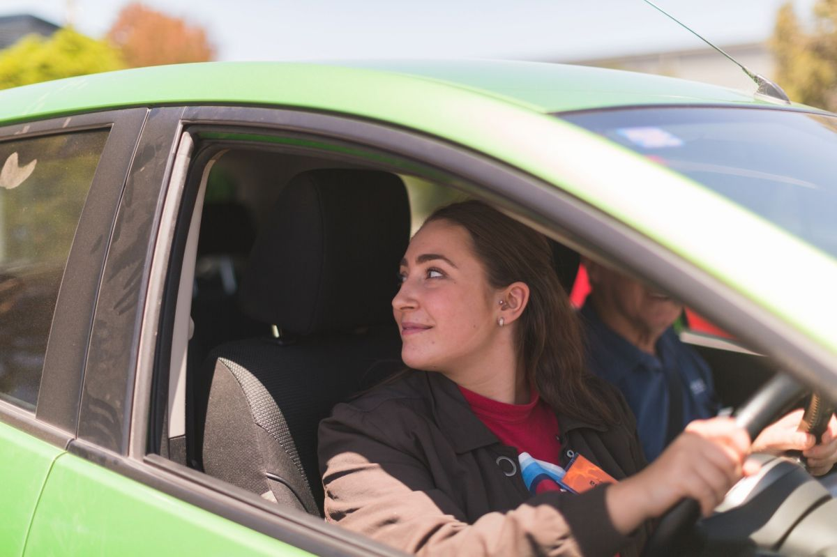 Green Mazda Student 3